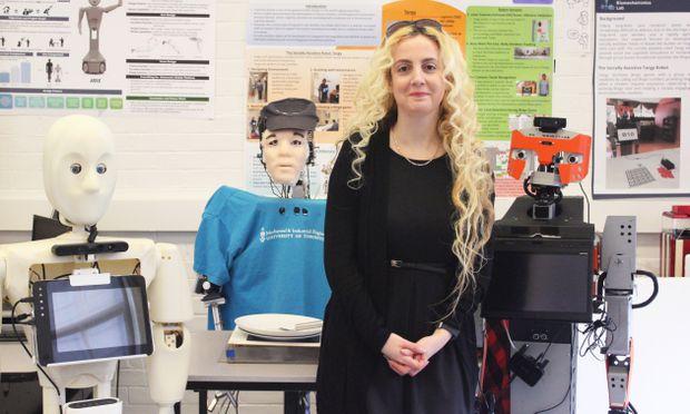 Prof. Goldie Nejat with elder-care robot prototypes. Photo courtesy Liz Do.