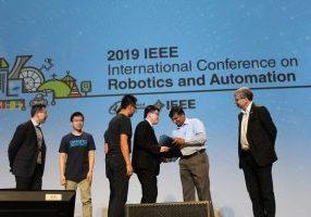 """Prof. Yu Sun's team receives Best Paper Automation award at ICRA 2019 for """"Robotic Orientation Control of Deformable Cells"""" (Changsheng Dai, Zhuoran Zhang, Yuchen Lu, Guanqiao Shan, Xian Wang, Qili Zhao, Yu Sun). Photo courtesy Xiaoyu Zhu."""
