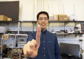 MASc student Tianqi Xu holds up a microrobot that was fabricated using their automated system. Photo courtesy Liz Do.